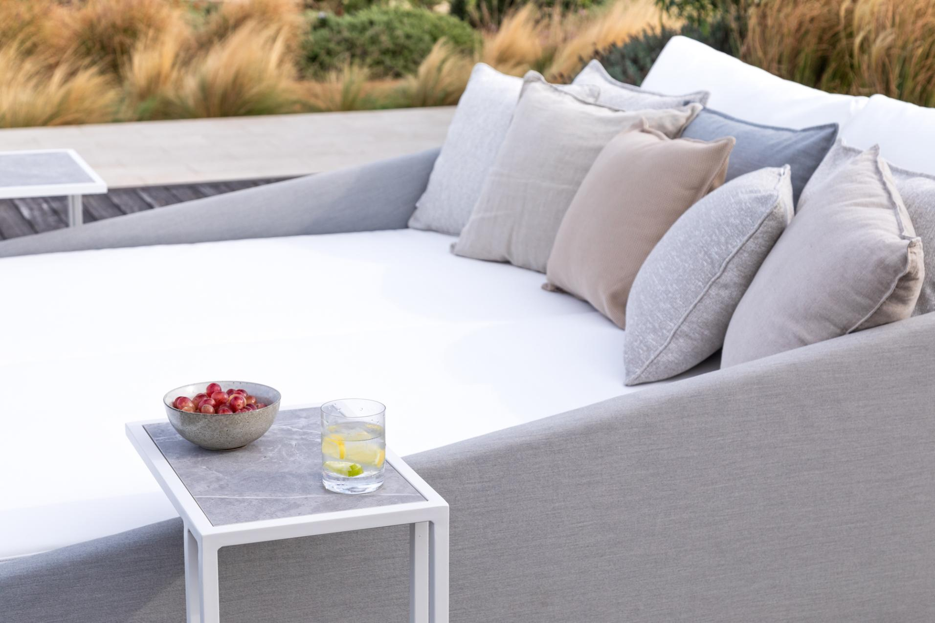 outdoor furniture trends: comfortable sun lounger with cushions